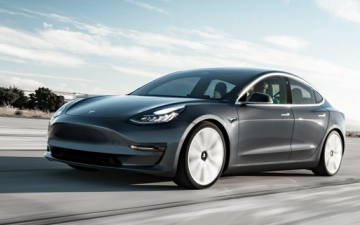 Rent Tesla Model 3 Standard Range Plus - grey (BEV)